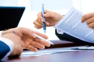 signing paperwork for a divorce